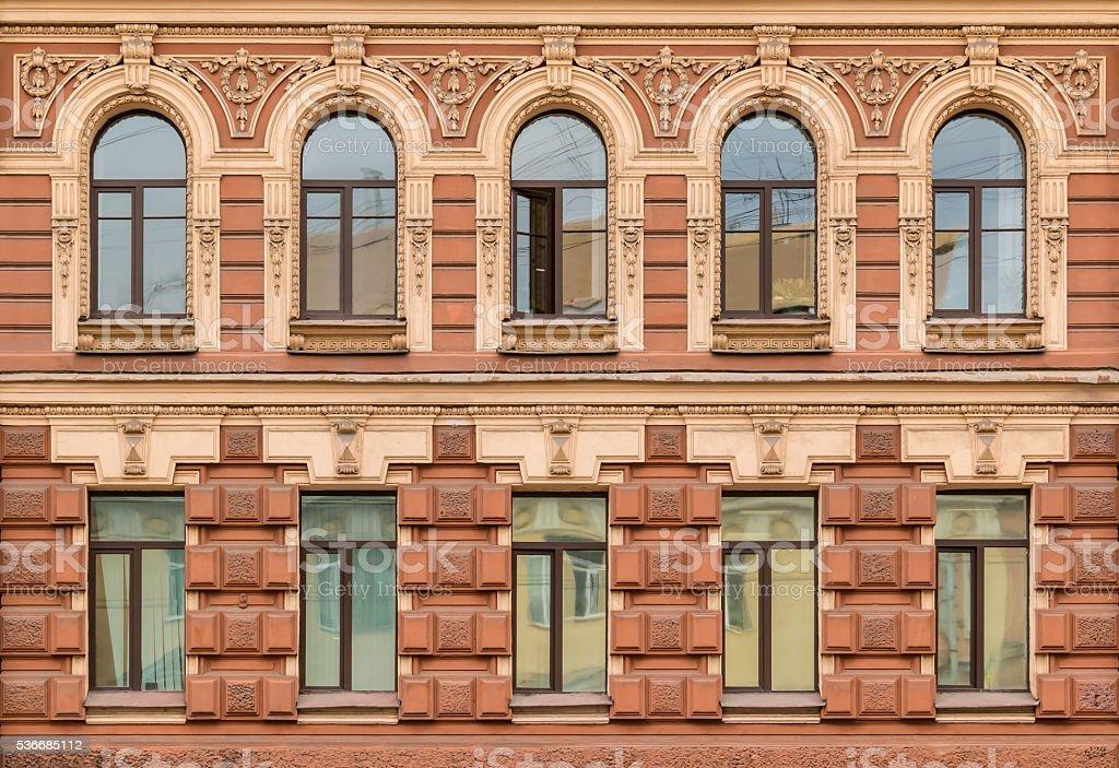 Windows in a row on facade of apartment building stock photo