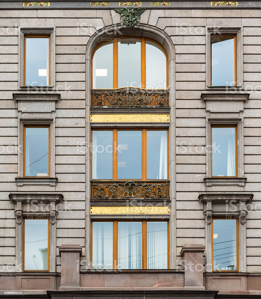 Windows in a row on facade of Singer House stock photo