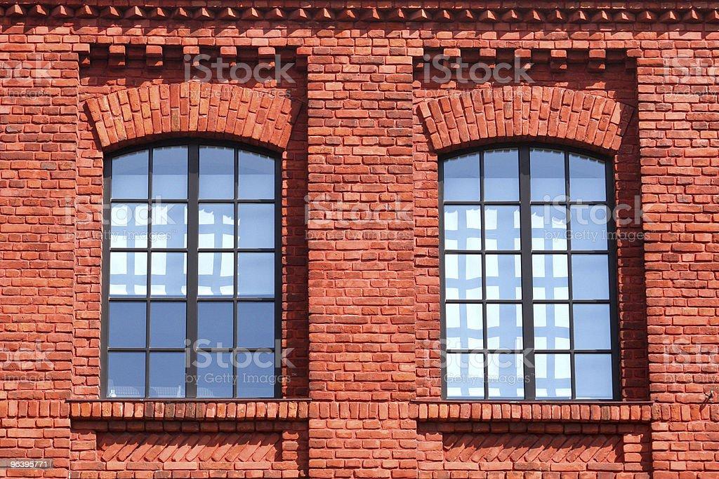 windows in brick house royalty-free stock photo