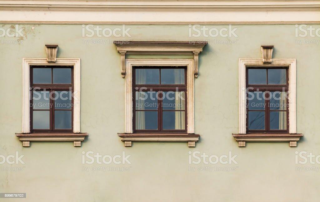 Windows in row on facade of historic building stock photo