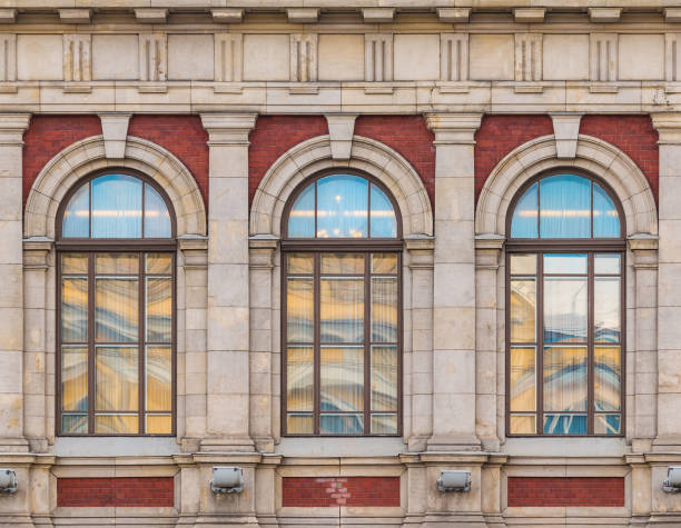 Windows in row on facade of historic building stock photo