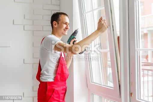 istock Windows installation worker. 1157003279
