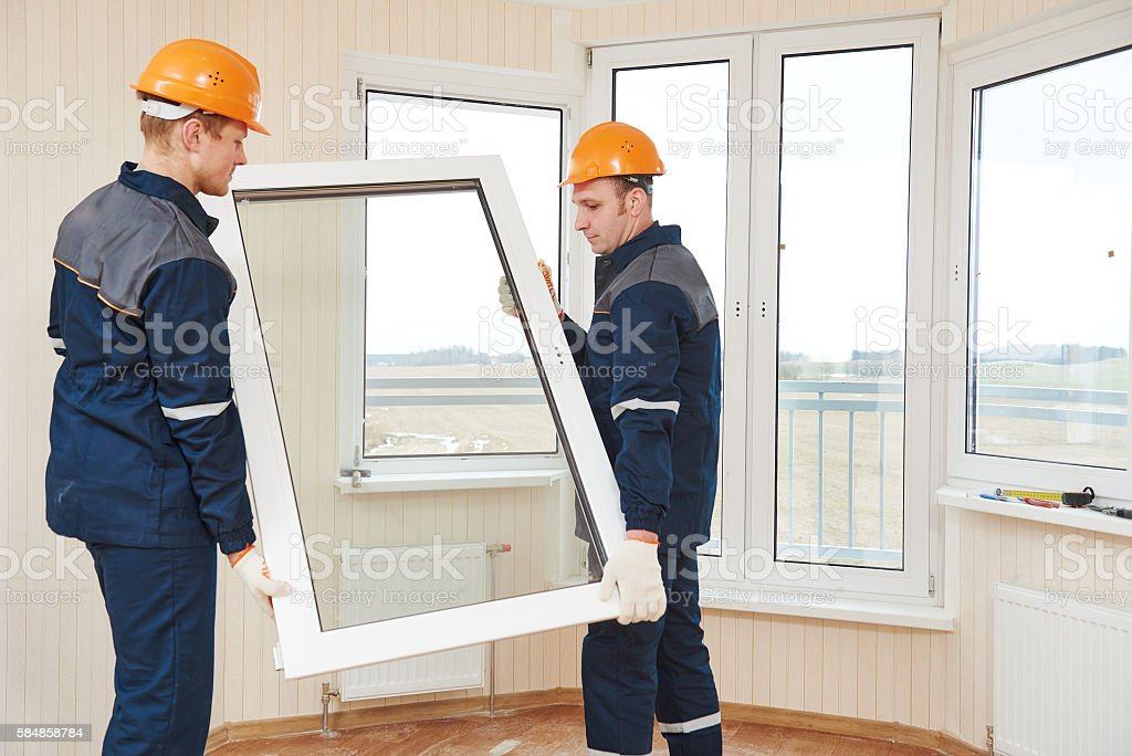 windows installation workers stock photo