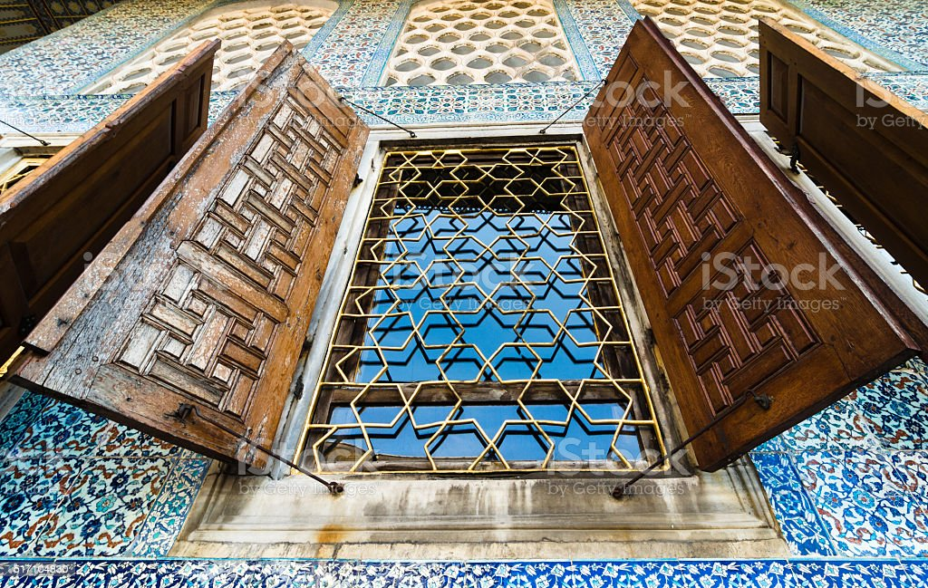 Windows into the harem at Topkapi Palace in Istanbul. stock photo
