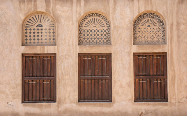 windows of an old Emirati house stock photo