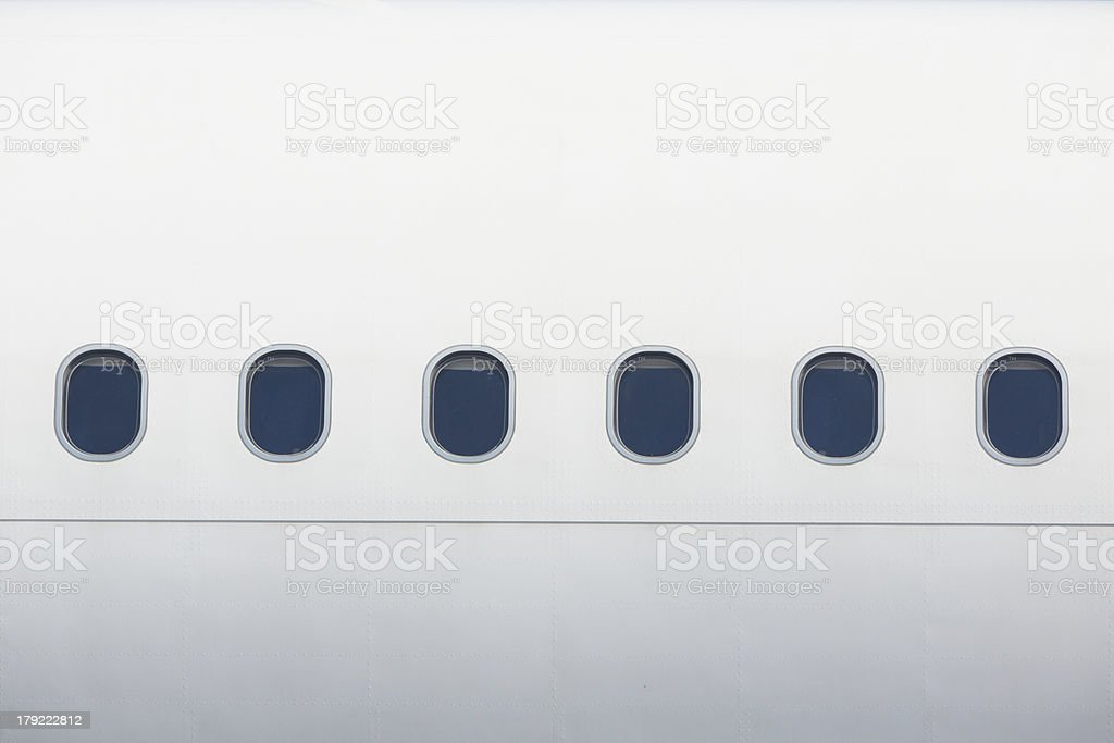 Windows of the airplane in white stock photo