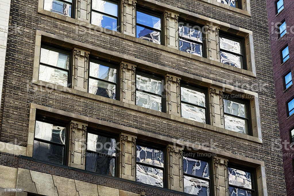 Windows of the Mentor Building in Chicago stock photo