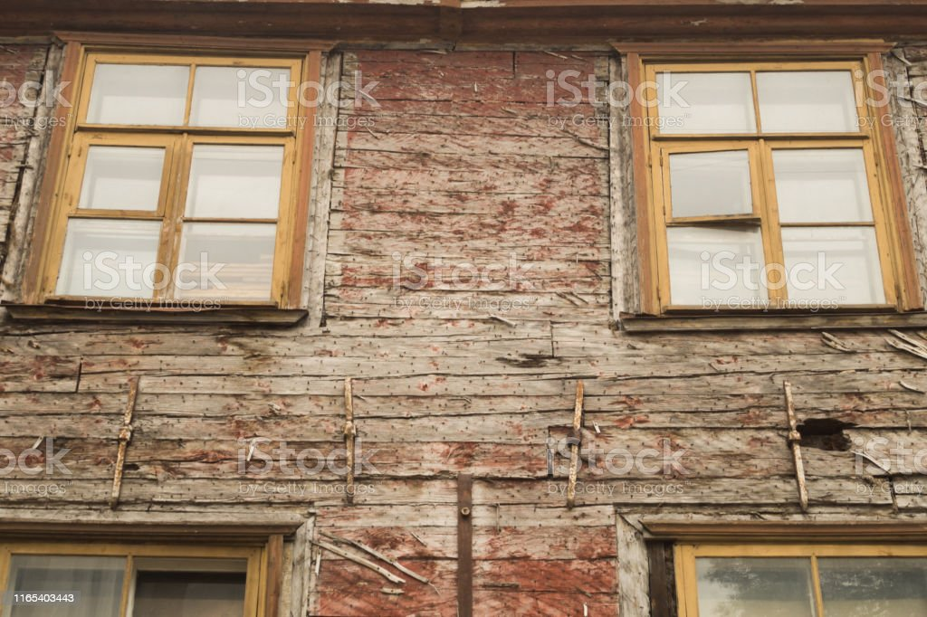 Windows of the old wooden house. wooden plank wall with windows...