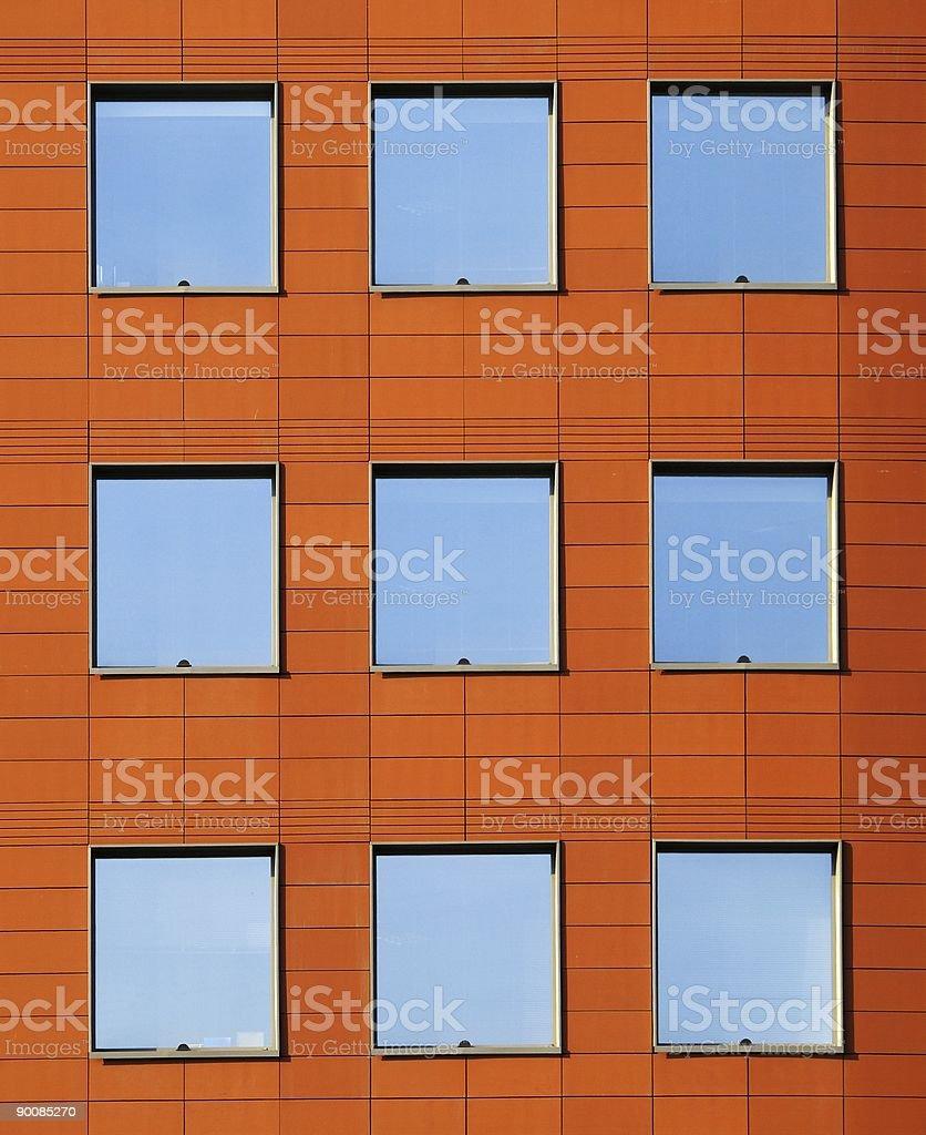 Windows on a orange wall royalty-free stock photo