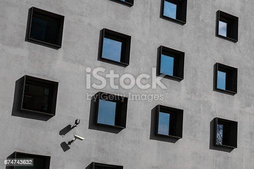 istock windows on building exterior, security cameras 674743632