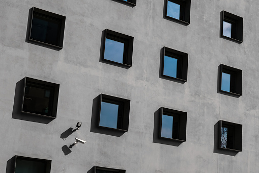 istock windows on building exterior, security cameras 674743632