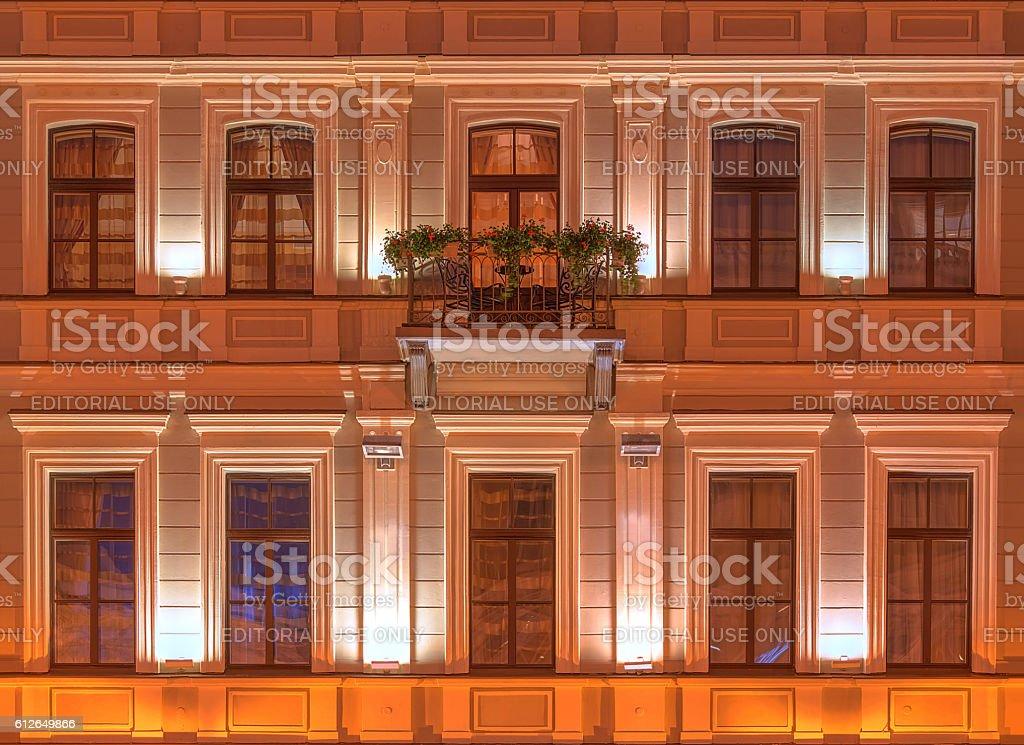 Windows on night facade of Kempinski Hotel Moika 22 stock photo