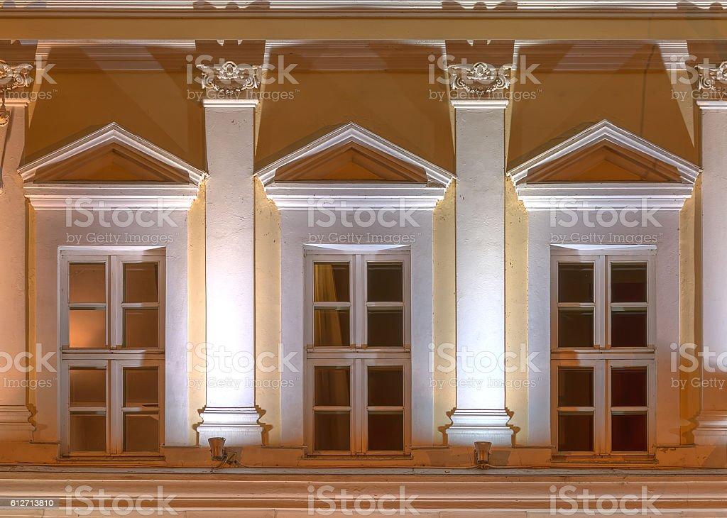 Windows on night facade of office building stock photo