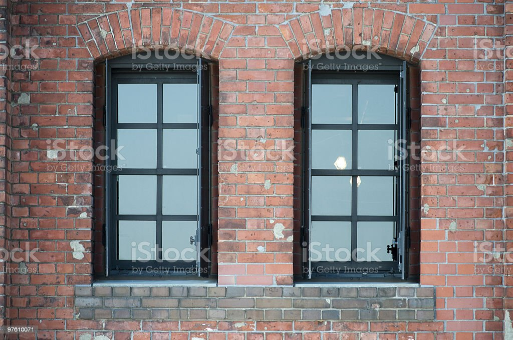 Windows on the brick wall royaltyfri bildbanksbilder