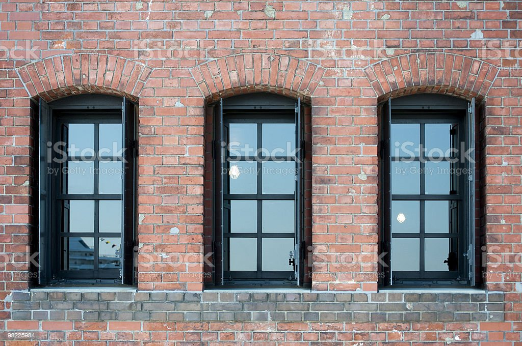 Windows on the brick wall royalty-free stock photo