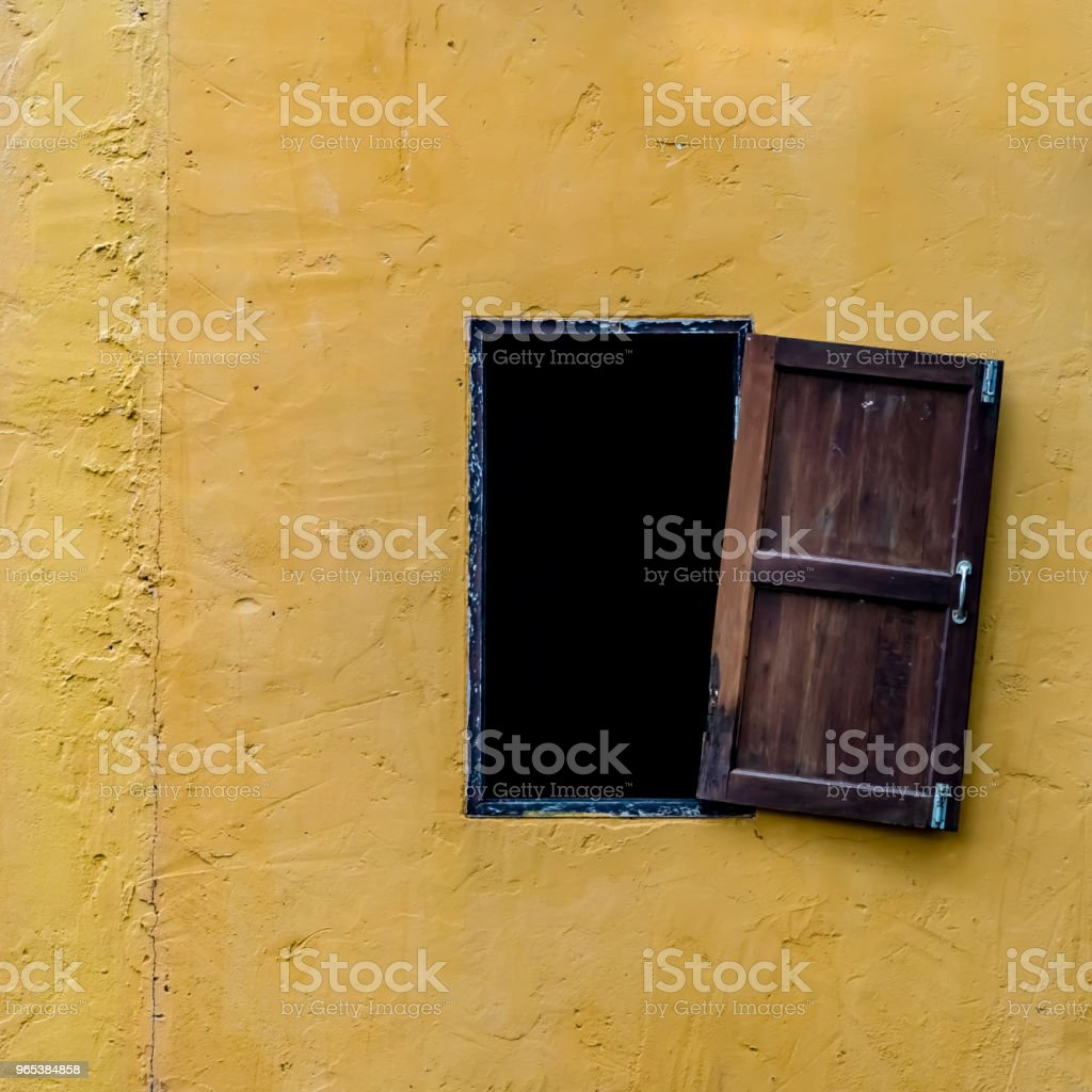 Windows on yellow concrete wall zbiór zdjęć royalty-free