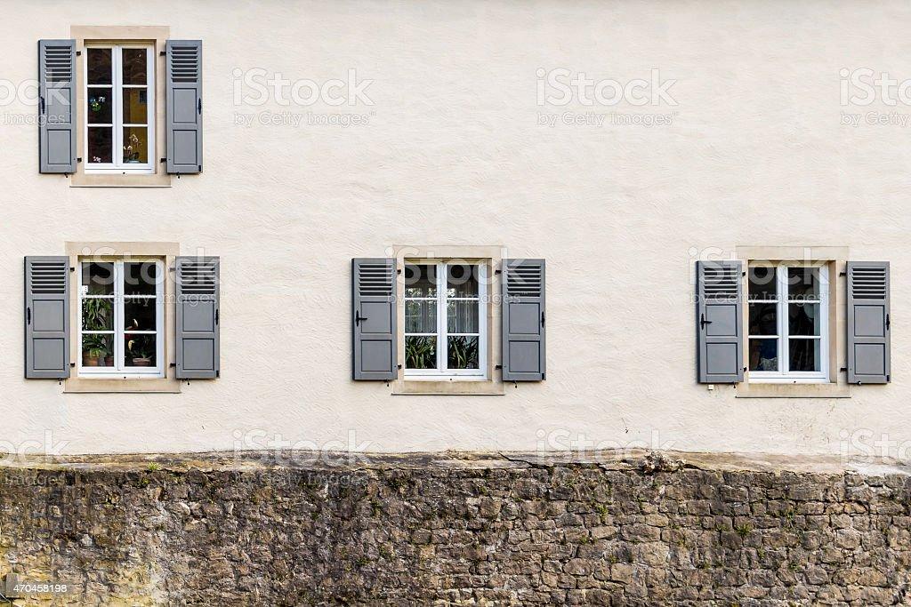 Windows shutters in larochette castle, luxembourg stock photo
