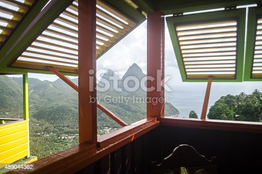 the pitons of soufriere st lucia greets viewers who open their window with a majestic imposing view.