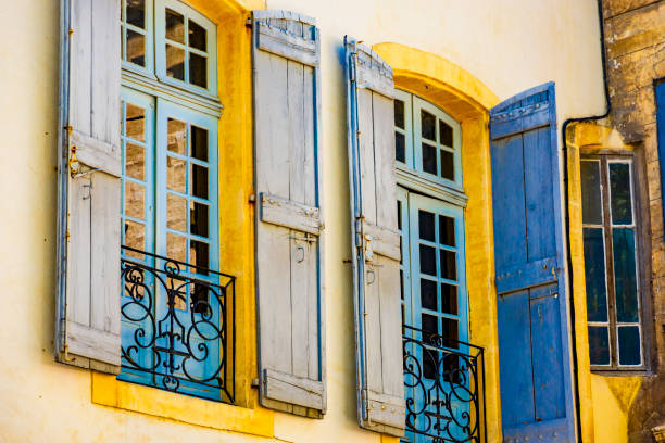 Windows with blue shutters in Avignon (Provence-Alpes-Côte d'Azur, France). stock photo