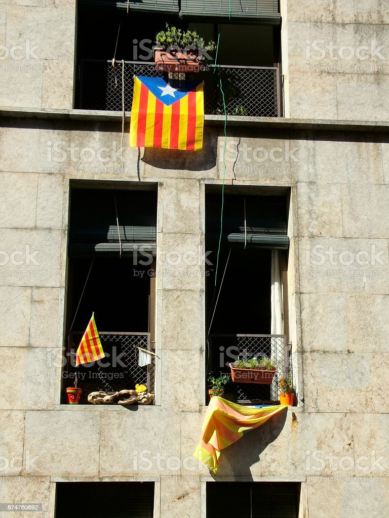 Windows with Catalan flags in the house of Girona, Spain stock photo