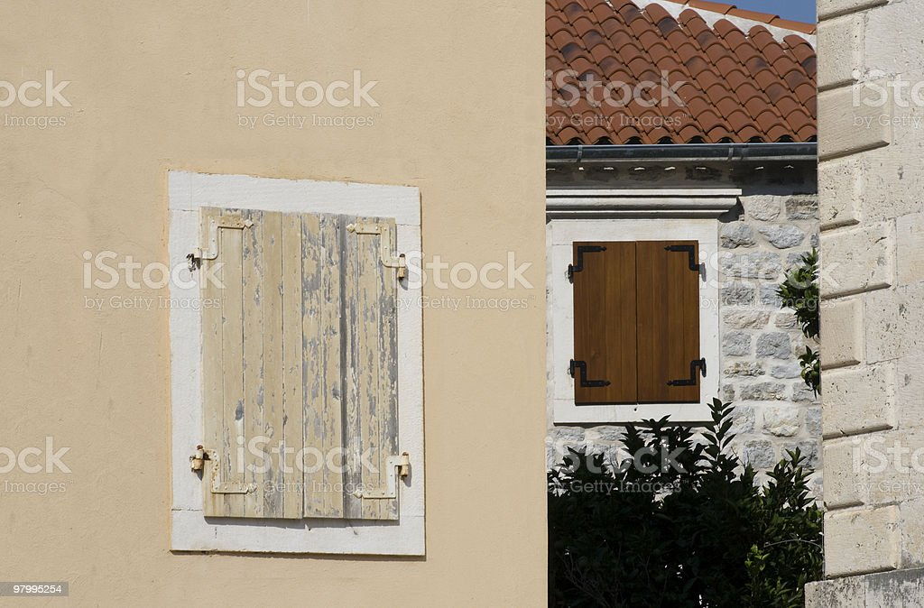 windows with closed shutter royalty free stockfoto