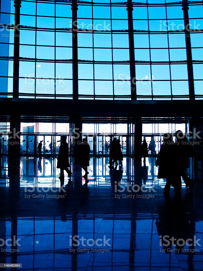 Windows with people in front and shadows of the people royalty-free stock photo