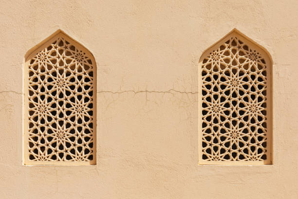 Windows with traditional decorative screens in Bahla, Oman. stock photo