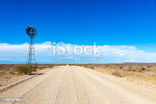 Windpump next to the gravel road in the Karoo South Africa