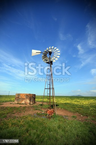 Windpump and dam outside on a farm in Africa. Note: Polarizer used and vignetting applied.