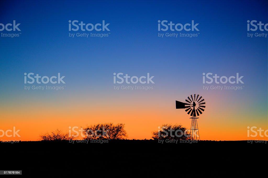 Windpump sunrise stock photo