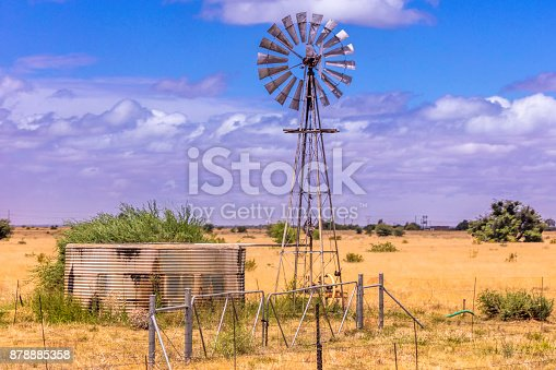 Windpump is a common site seen throughout South African rural countryside, together with the adjacent water tank to store the water for farming. A South African-style windmill.