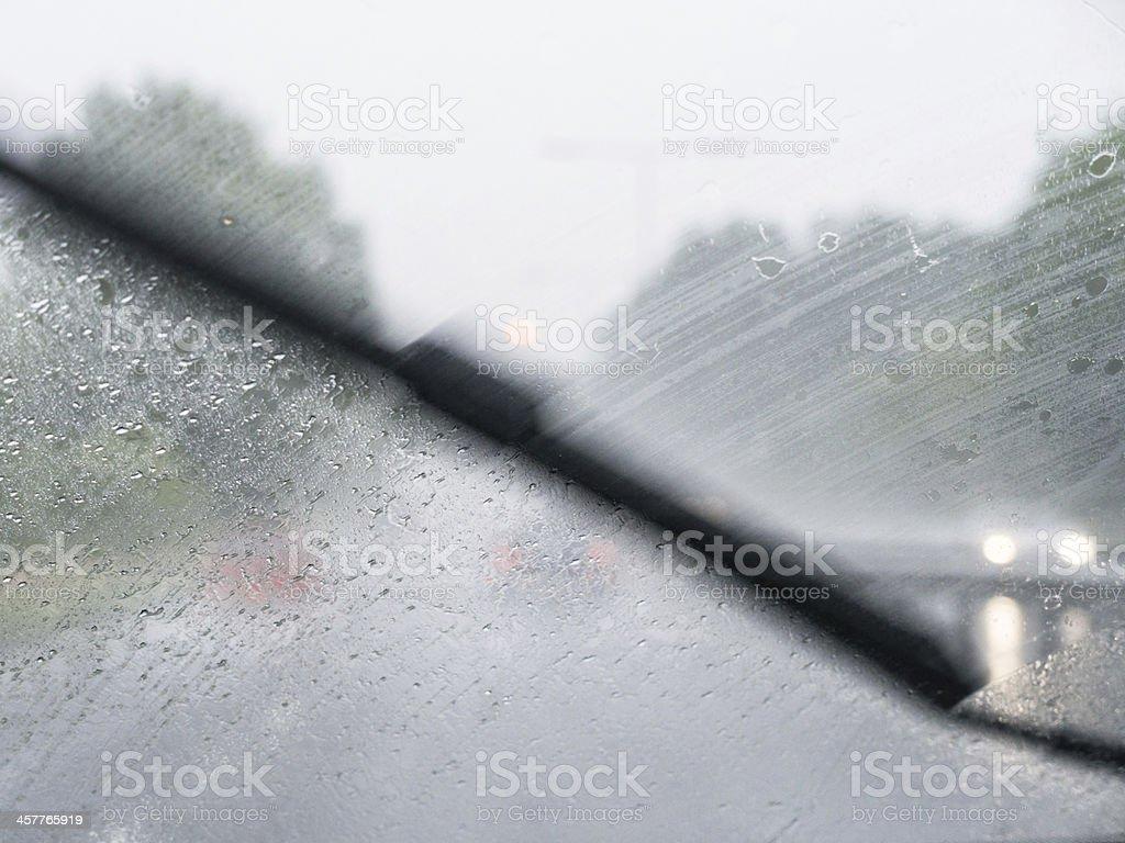 Windscreen wiper blocks the view on a rainy day stock photo