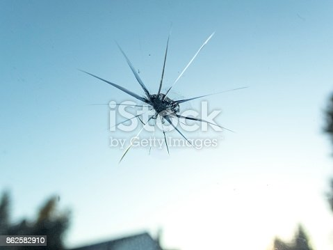 istock Windshield of Car with Small Rock Chip Close-up from Inside 862582910