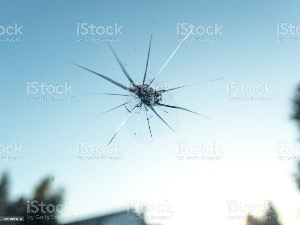 Windshield of Car with Small Rock Chip Close-up from Inside stock photo