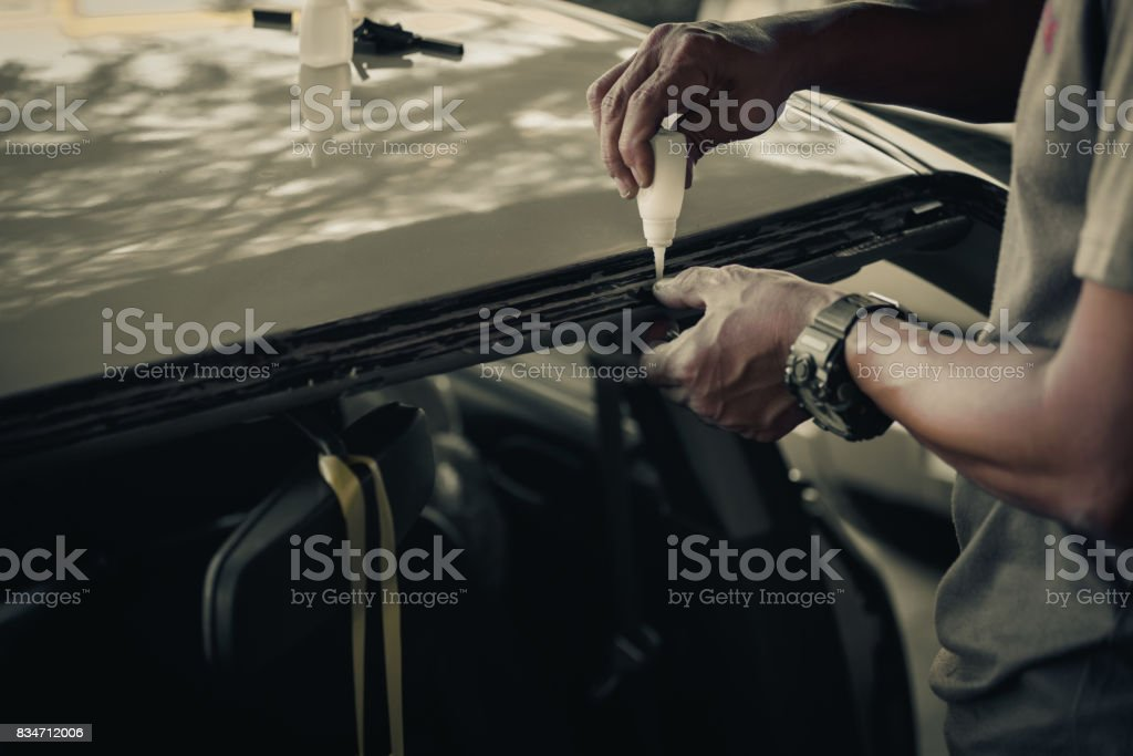windshield repair and install auto glass because car accident stock photo