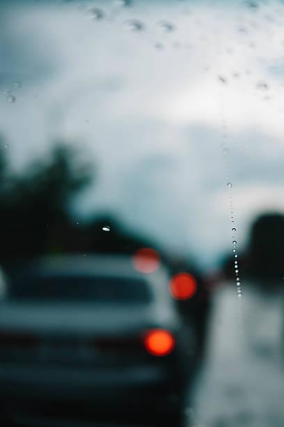 Windshield traffic view on a dark autumn day