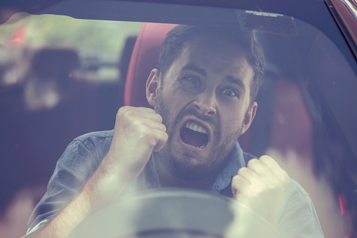istock Windshield view of an angry driver man. Negative human emotions face expression 664857740