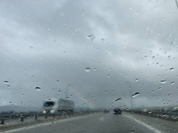 Windshield view of highway bad weather. stock photo
