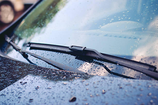 Windshield wiper in rain Windshield wiper in rain windshield wiper stock pictures, royalty-free photos & images