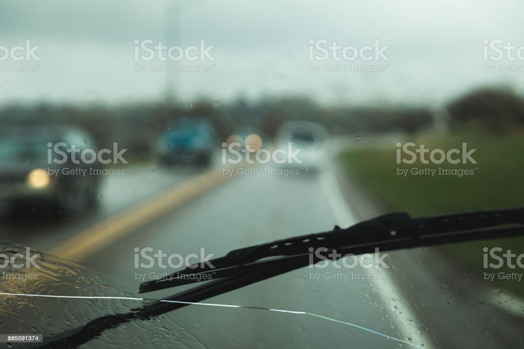 Windshield Wiper on Cracked Windshield stock photo