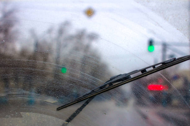 Windshield wipers from inside of car, season rain. Windshield wipers from inside of car, season rain. windshield wiper stock pictures, royalty-free photos & images