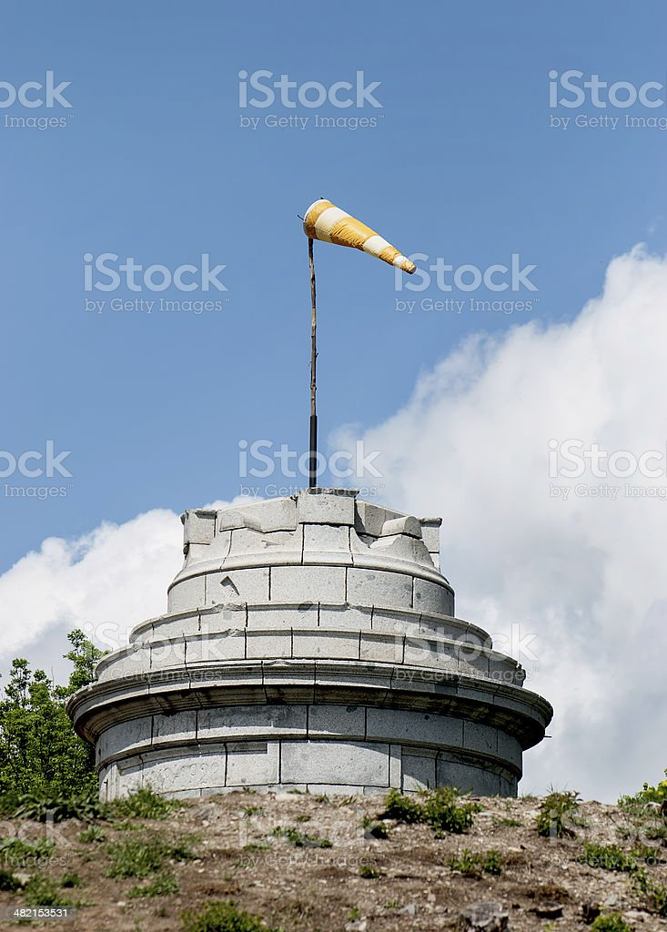 Windsock on the stone tower stock photo