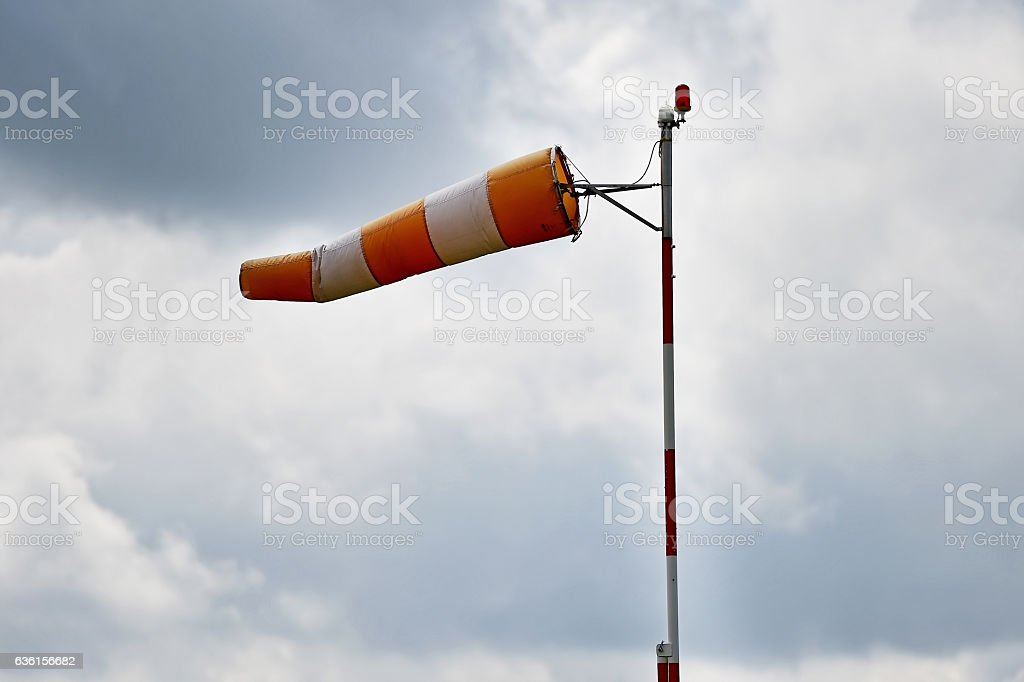 Windsock with overcast sky - foto stock