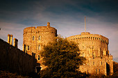 A golden hour establishing shot of the Windsor Castle in England, UK