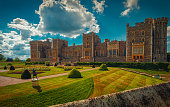 An ultra wide view of the medieval Windsor Castle and gardens bathed in glorious sunny weather