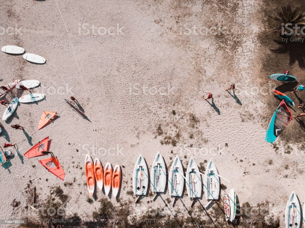 Windsurf boards on the sand at the beach stock photo