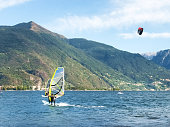 Several windsurfing and kitesurfing with thermal wind from the south on Lake Como.