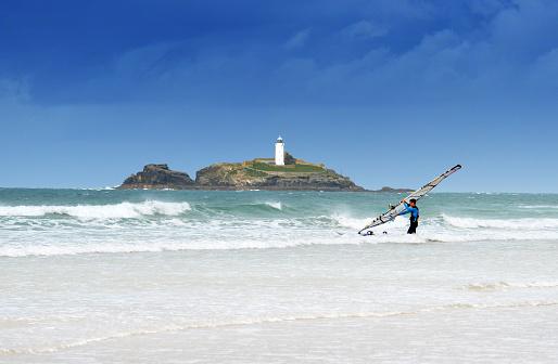 Windsurfer launching at Gwithian