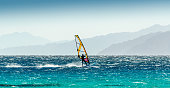 windsurfer rides on a background of high mountains in Egypt Dahab