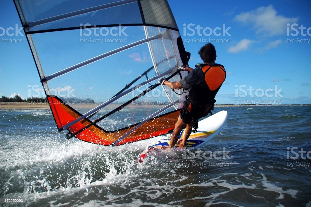 Windsurfer speeding past royalty-free stock photo
